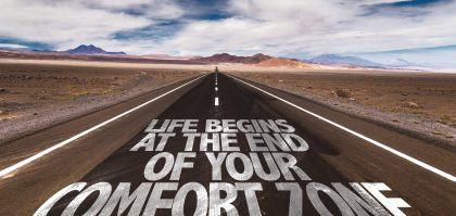 Life Begins at the End of your Comfort Zone written on desert road